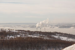 Smokestacks spew Pollution Carbon dioxide in the atmosphere Royalty Free Stock Photography