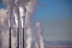 Smokestacks. Three Factory Smokestacks Spewing Into Air royalty free stock photos
