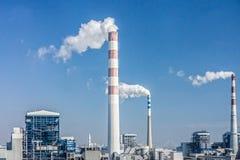 Smokestacks and white smoke Stock Image