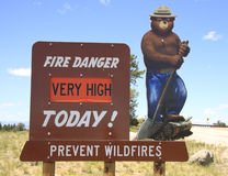 Smokey bear fire sign. Sign in the Pike National Forest, Rocky Mountains, Colorado, of Smokey Bear warning of very high fire danger Stock Image