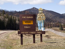 Smokey Bear Sign with Burned Mountain Backdrop Royalty Free Stock Image