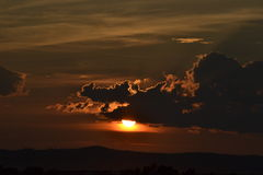 A smokey decent. The sun setting through a smokey haze Royalty Free Stock Image