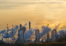 Smokey industry. Industry plant in the harbor with smoke against sunset royalty free stock photo