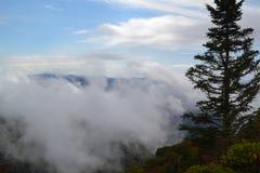 A Smokey Mountain peak in clouds Stock Photos