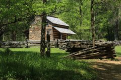 Smokey Mountains Log Cabin. Surrounded with split rail fence - `John Oliver Cabin Stock Photos