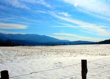 Smokey Mountains. A snowy valley rest below the snowy Smokey Mountains Stock Photos