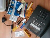 Smokey office phone. Shag usb cigaretfilter Royalty Free Stock Photo