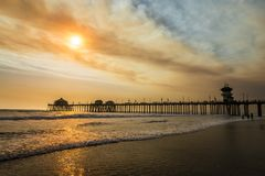 Smokey skies over Huntington Beach pier Royalty Free Stock Photography