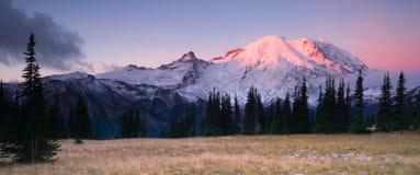 Smokey Sunrise Mt Rainier National Park Cascade Volcanic Arc. The morning sun just starting to hit the tip of Mount Rainier Royalty Free Stock Image