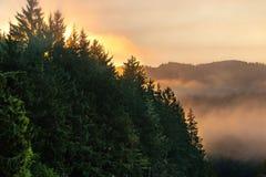 Smokey sunrise over mountains Royalty Free Stock Images