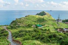 Smoki przewodzą dojechanie w ocean przy Yongmeori plażą, Ro, Jeju wyspa, Południowy Korea Zdjęcie Stock