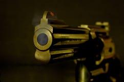 Smokin' Gun. Looking down the barrel of a smoking .357 magnum revolver stock photography