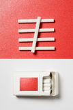 About Smoking. Pack of Cigarettes on white and some cigarettes on red paper background Royalty Free Stock Photos