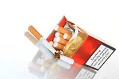 Smoking. A close up image of a cigarette box on a table stock photo