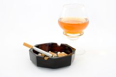 Smoking. Cigarettes in the ashtray, over white background Royalty Free Stock Photo
