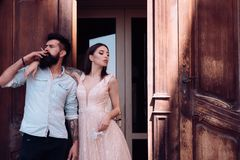 Smoking addiction. Couple in love have smoking break. Romantic couple of sensual woman and bearded man smoke outdoor royalty free stock images