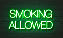 Smoking allowed neon sign on brick wall background. Smoking allowed neon sign on brick wall background Royalty Free Stock Photos