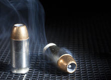 Smoking ammo Stock Image