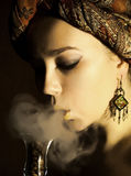 Smoking arabic girl Stock Images