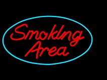 Smoking area. Neon sign isolated on black Royalty Free Stock Photos