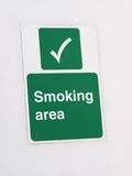 Smoking Area. Green sign on white wall for a designated smoking area Royalty Free Stock Image