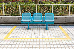 Smoking area with blue bench Royalty Free Stock Image