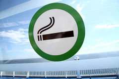 Smoking area. Picture of a sign marking the designated smoking area on a window Stock Images