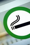 Smoking area. Picture of a sign marking the designated smoking area on a window Royalty Free Stock Images
