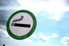Smoking area. Picture of a sign marking the designated smoking area on a window Stock Photos