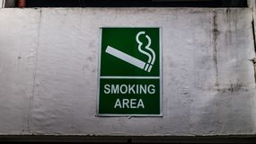 Smoking area sign. Mounted on the wall of public space Stock Photos