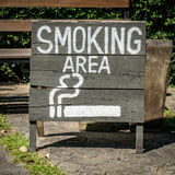 Smoking area sign on wood board Stock Photo