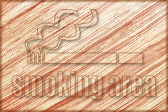 Smoking area sign on wooden board Stock Photo