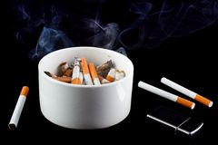 Smoking ashtray Stock Photos