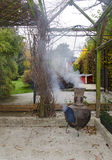 Smoking aztec oven. On a terrace in autumn Royalty Free Stock Photo