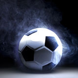 Smoking ball. Soccer ball full of smoke on black background Stock Photo