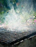 Smoking barbecue. Grill being prepared for meat cooking Royalty Free Stock Photo