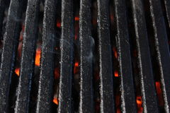 Smoking barbecue grill with flames Royalty Free Stock Photos