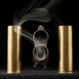 Smoking barrel of rifle Stock Photos