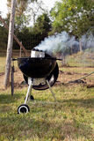 Smoking bbq grill outside Stock Photos
