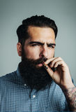Smoking of bearded brutal man Royalty Free Stock Photos