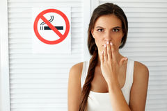 Smoking. Beautiful Woman With No Smoking Sign On Background Royalty Free Stock Photos