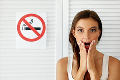 Smoking. Beautiful Woman With No Smoking Sign On Background stock photo