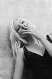 Smoking beautiful young woman. Black and white Stock Photo