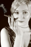 Smoking beauty girl. Sepia Stock Images