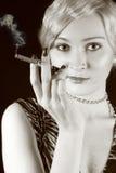 Smoking beauty girl. Sepia Stock Images