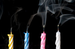 Smoking birthday candles on black Royalty Free Stock Photography