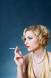 Smoking blond woman Stock Photography