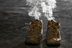 Smoking Boots Stock Image