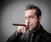 Smoking boss Royalty Free Stock Image