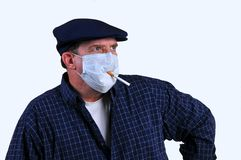 Smoking with a breathing mask on Stock Images